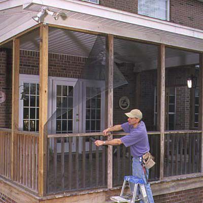 Man Removing Wood Battens From Screened Porch