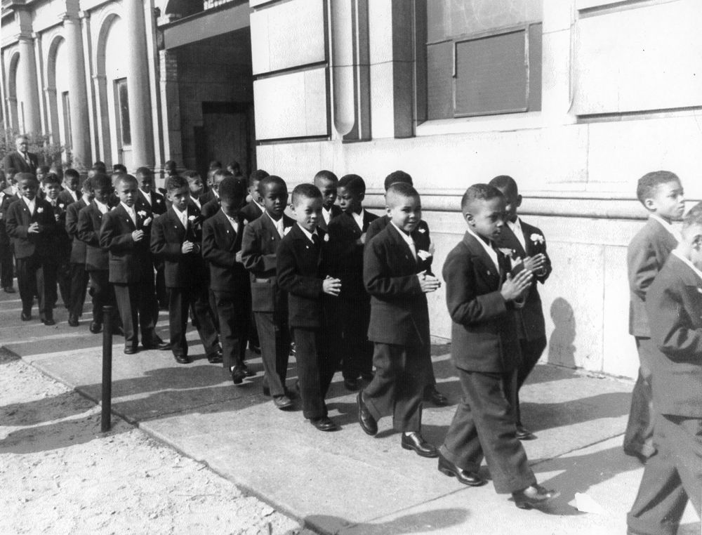 In this archive photo, students at the one time Corpus Christi Elementary School prepare for their First Holy Communion at Corpus Christi Church, 4920 S. King Drive.