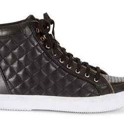 """There's no cooler way to <i>literally</i> run after your kids than in the <b>Rebecca Minkoff Sandi Too Sneakers</b>. The quilted black leather and gold zipper details will look great with her daily denim. Available for $225 at <a href=""""http://www.rebeccam"""