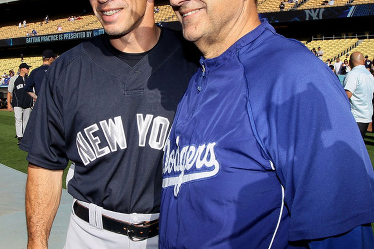 LOS ANGELES, CA - JUNE 25:  Manager Joe Girardi of the New York Yankees greets manager Joe Torre of the Los Angeles Dodgers before their game on June 25, 2010 at Dodger Stadium in Los Angeles, California.  (Photo by Stephen Dunn/Getty Images)