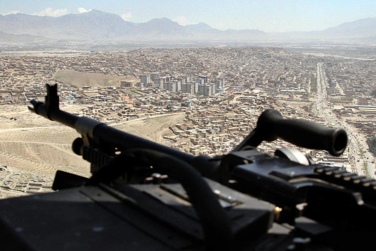 A U.S. Chinook helicopter flies over Kabul, Afghanistan, during a visit of NATO Secretary-General Anders Fogh Rasmussen, Thursday, April 12, 2012. NATO said Thursday it is on track to fully hand over responsibility for securing Afghanistan to local forces