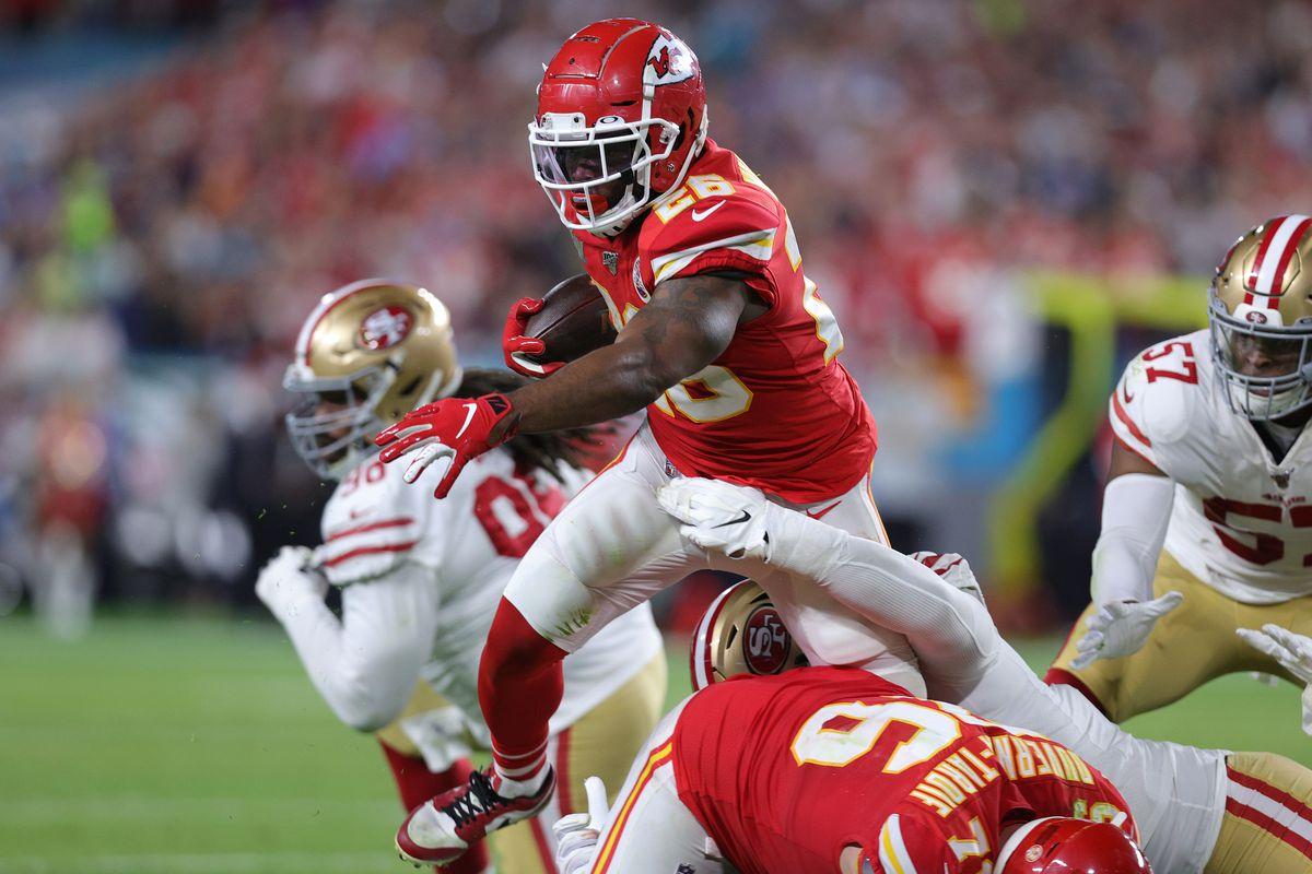 Damien Williams of the Kansas City Chiefs rushes the ball against San Francisco 49ers defense in the second quarter Super Bowl LIV at Hard Rock Stadium on February 02, 2020 in Miami, Florida.