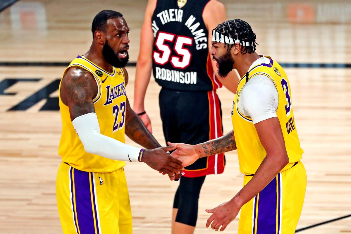 Los Angeles Lakers forward Anthony Davis celebrates with forward LeBron James after a play during the third quarter against the Miami Heat in game one of the 2020 NBA Finals at AdventHealth Arena.