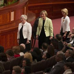The newly called Young Women presidency, President Bonnie Lee Green Oscarson president and and her counselors, Sisters Carol Louise Foley McConkie and Evelyn Neill Foote Marriott, walk to their seats on the stand during the afternoon session Saturday, April 6, 2013 of the 183th Annual General Conference of The Church of Jesus Christ of Latter-day Saints in the Conference Center.