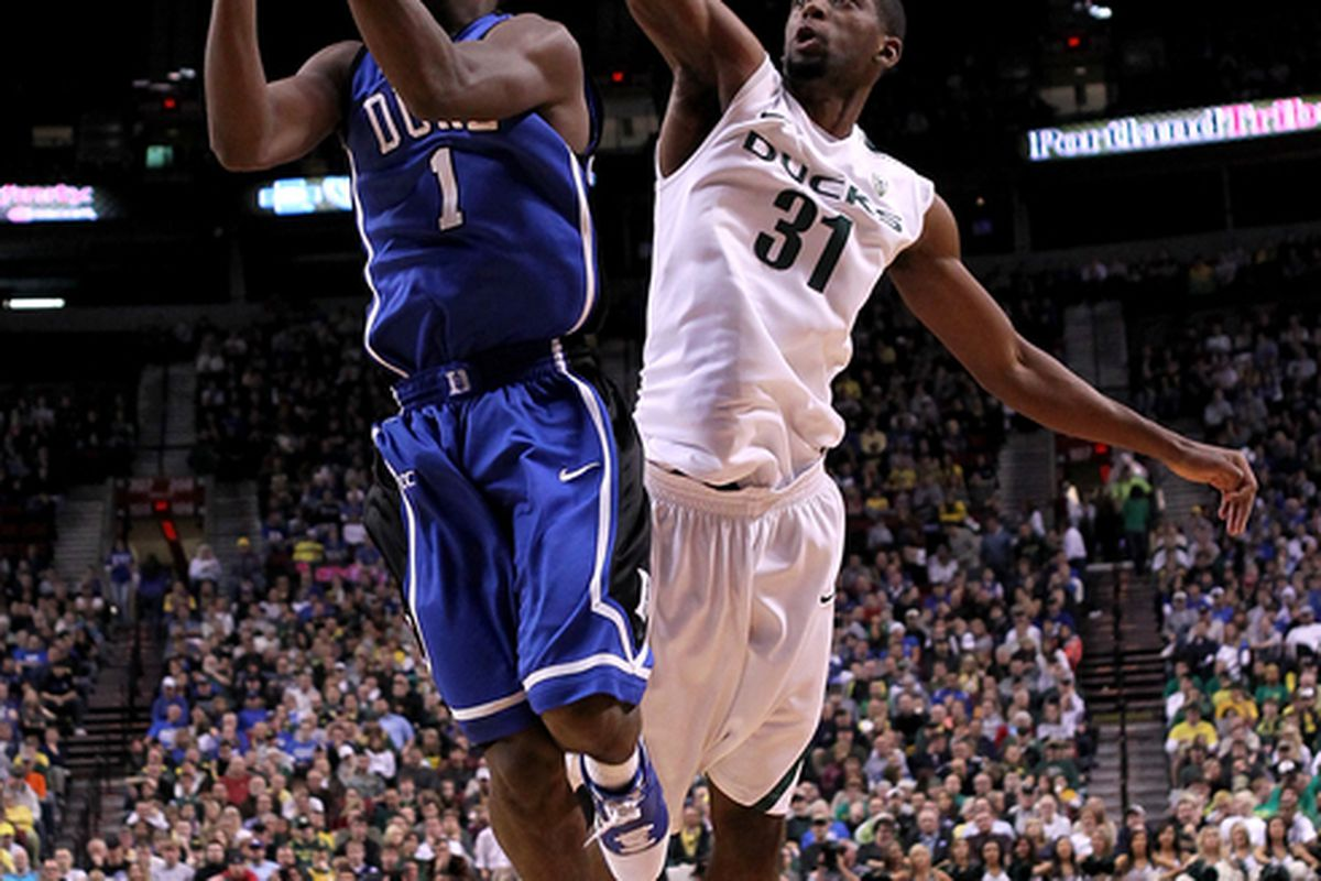 PORTLAND OR - NOVEMBER 27:  Kyle Irving #1 of the Duke Blue Devils goes for a layup against Tyrone Nared #31 of the Oregon Ducks on November 27 2010 at the Rose Garden in Portland Oregon.  (Photo by Jonathan Ferrey/Getty Images)