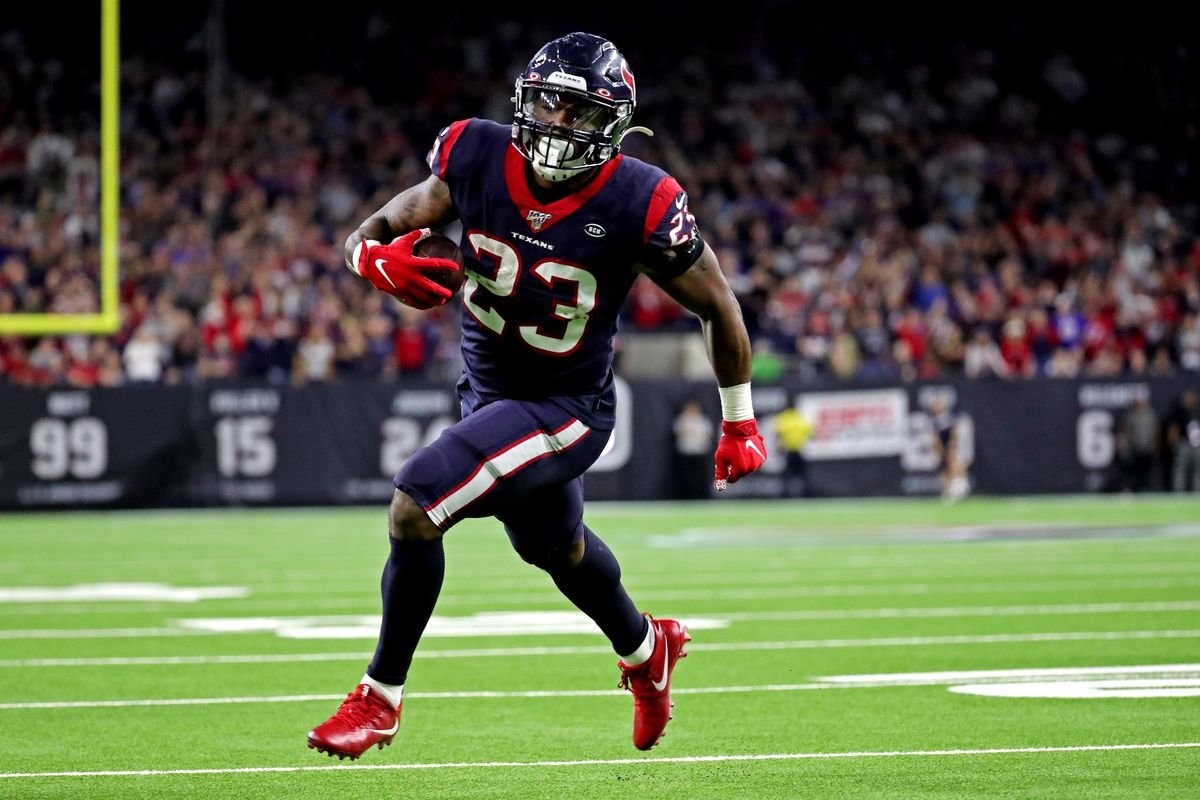 Houston Texans running back Carlos Hyde runs for a touchdown during the fourth quarter against the Buffalo Bills in the AFC Wild Card NFL Playoff game at NRG Stadium.