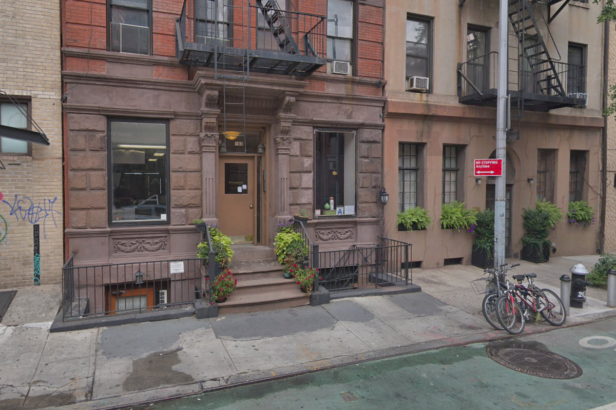 A brownstone building with a tearoom in the first floor