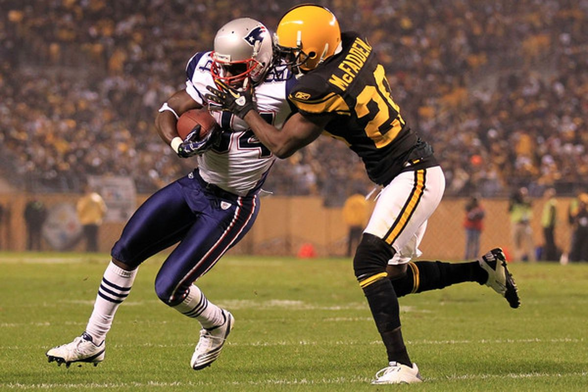 PITTSBURGH - NOVEMBER 14:  Deion Branch #84 of the New England Patriots is tackled Bryant McFadden #20 of the Pittsburgh Steelers on November 14 2010 at Heinz Field in Pittsburgh Pennsylvania.  (Photo by Chris McGrath/Getty Images)