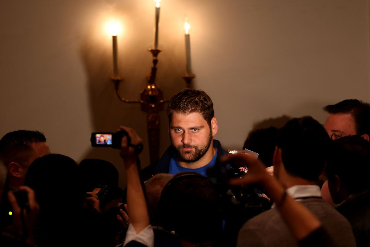 Sebastian Vollmer answers questions after arriving in London early this morning.