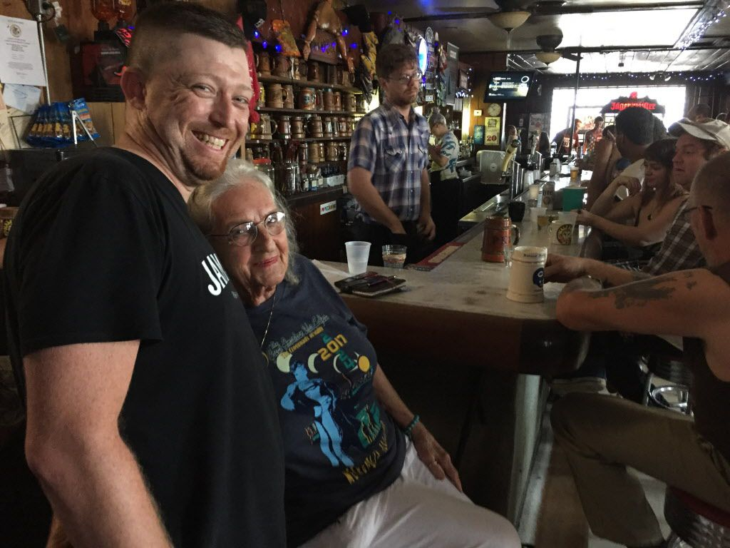 PK's Bar manager Curtis Conley, left, with owner Gwen Hunt, who started the Carbondale bar 62 years ago. It closed for a half hour during the totality of the eclipse so patrons and employees could go outside and see it. | Neil Steinberg/Sun-Times