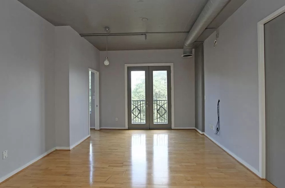 Empty living room with french doors in the background.