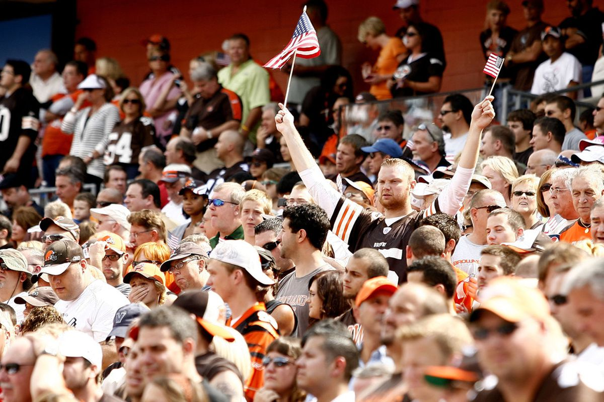 CLEVELAND, OH - SEPTEMBER 11:  Fans listen to the national anthem prior to the Cleveland Browns and Cincinnati Bengals game at Cleveland Browns Stadium on September 11, 2011 in Cleveland, Ohio.  (Photo by Matt Sullivan/Getty Images)