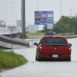 A motorist stops in deep water during Tropical Storm Harvey in Houston on Tuesday, Aug. 29, 2017.
