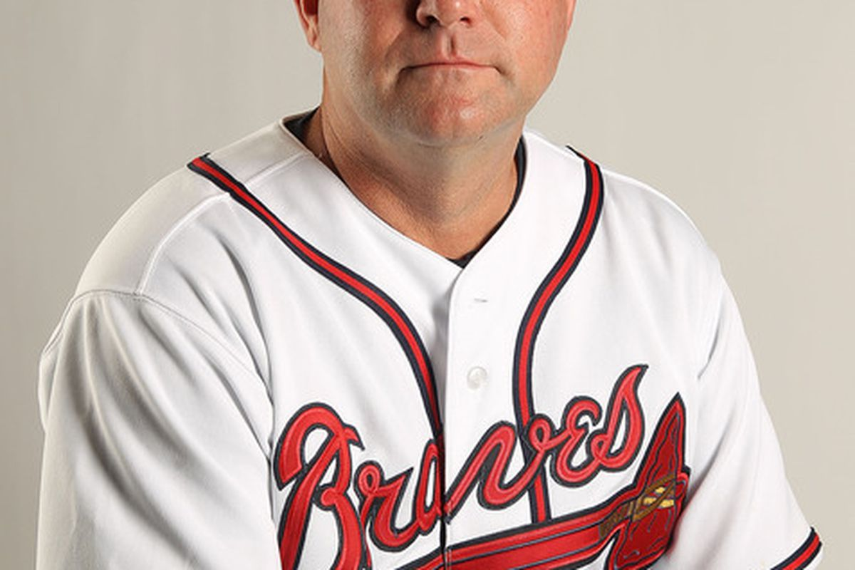 LAKE BUENA VISTA FL - FEBRUARY 21: Coach Roger McDowell #45 of the Atlanta Braves during Photo Day at  Champion Stadium at ESPN Wide World of Sports of Complex on February 21 2011 in Lake Buena Vista Florida.  (Photo by Mike Ehrmann/Getty Images)