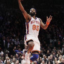 New York Knicks' Baron Davis (85) drives to the basket during the first half of an NBA basketball game against the Washington Wizards Friday, April 13, 2012, in New York.