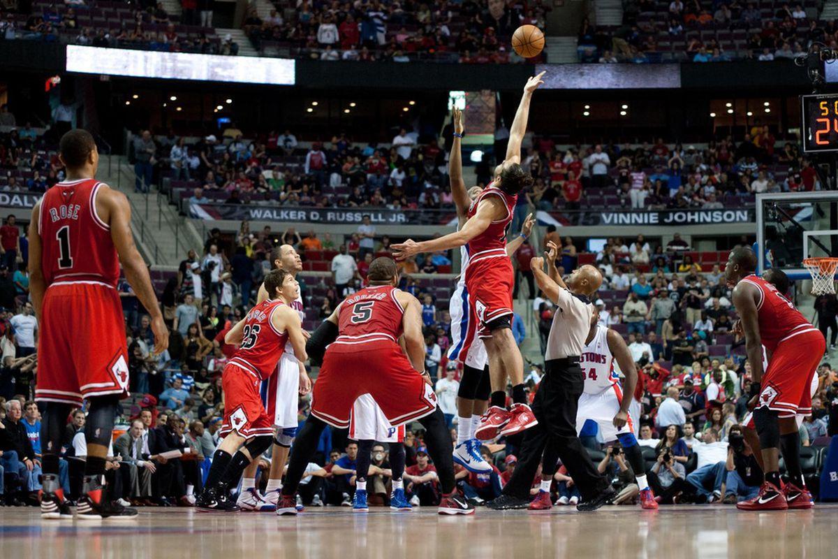 April 15, 2012; Auburn Hills, MI, USA; Chicago Bulls center Joakim Noah (13) and Detroit Pistons center Greg Monroe (10) go up for the jump ball in overtime at The Palace. Chicago won 100-94 in overtime. Mandatory Credit: Tim Fuller-US PRESSWIRE