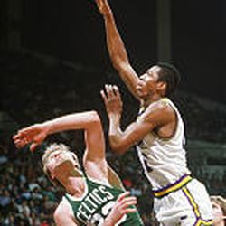 Jazz player Thurl Bailey shoots over Larry Bird in the 1980s.