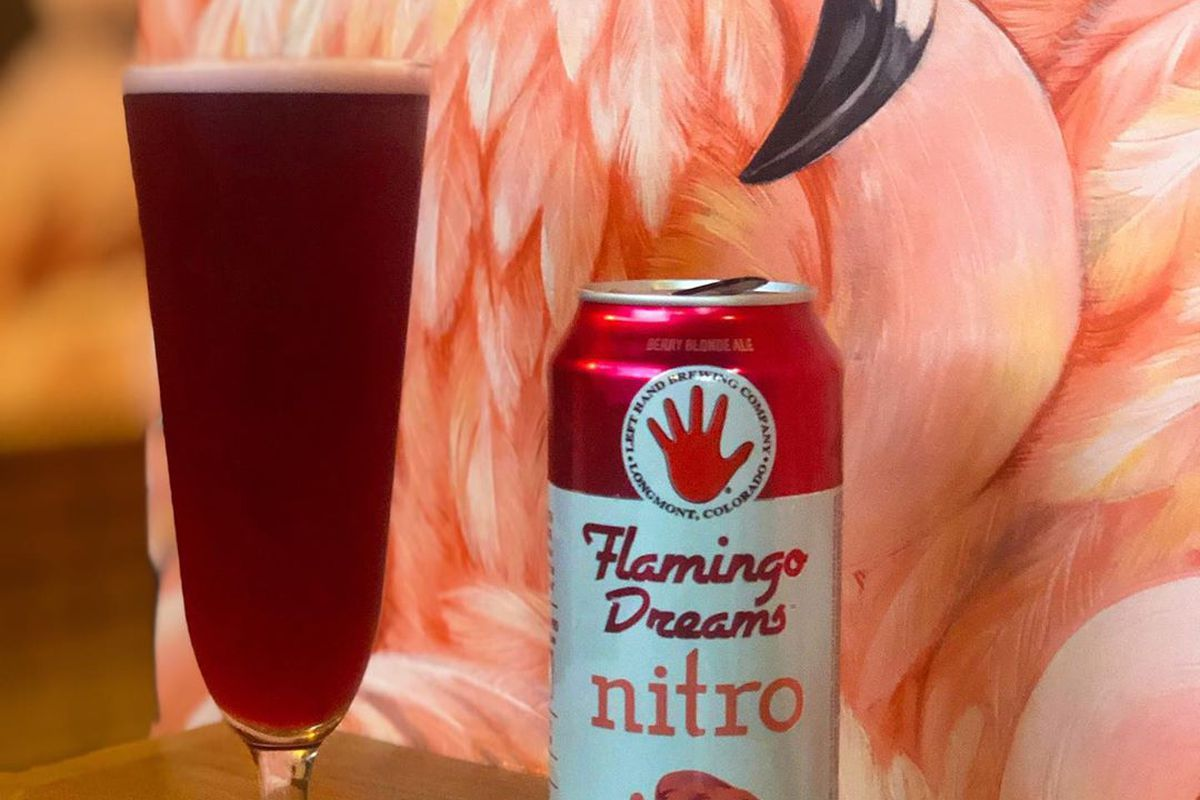 A Flamingo Dreams beer can sits in front of flamingo wallpaper