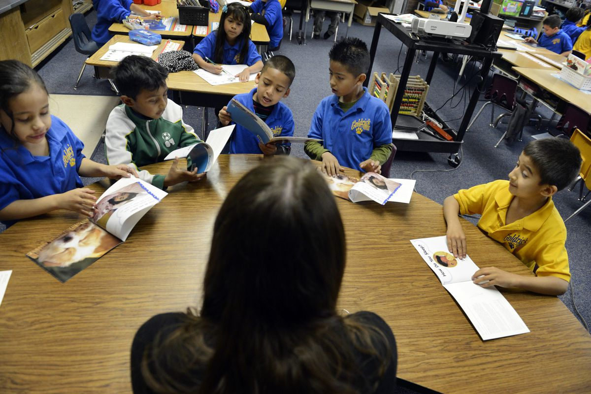 Students read in a Colorado first-grade class. The Common Core is having an impact on what books teachers choose to use in their classrooms.