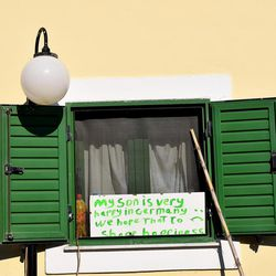 A sign in a window at the Kyllini refugee camp in Myrsini, Greece, July 11, 2016, describes a Syrian family's hope to join their son in Germany.
