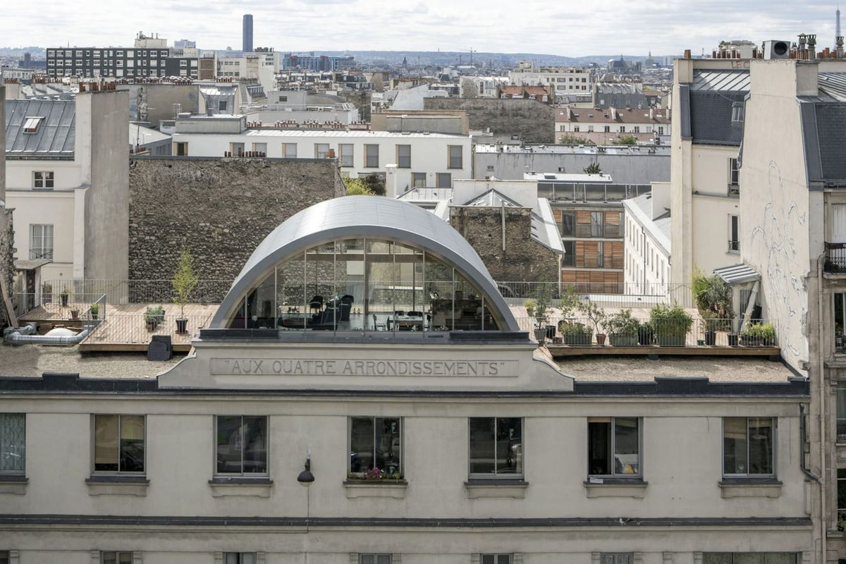 Prefab barrel-vaulted roof extension in Paris