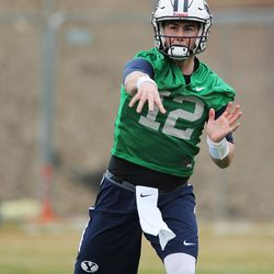 Brigham Young Cougars quarterback Tanner Mangum (12) throws during practice in Provo on Tuesday, March 1, 2016.