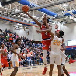 Simeon's Jaylen Granger (24) hits Curie's DaJuan Gordon (3) in the face going to the basket, Saturday 12-29-18. Worsom Robinson/For Sun-Times