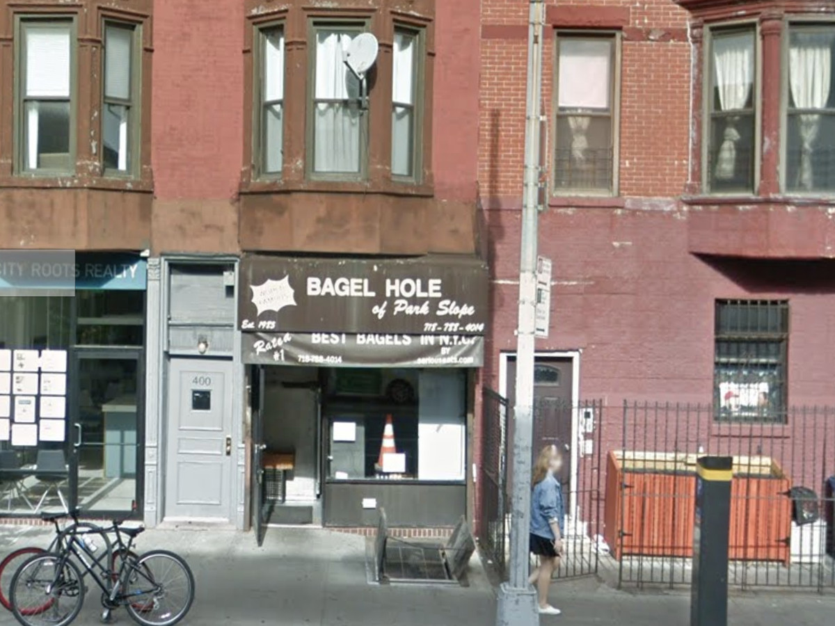 The exterior of the shop Bagel Hole in park slope which has a brown awning