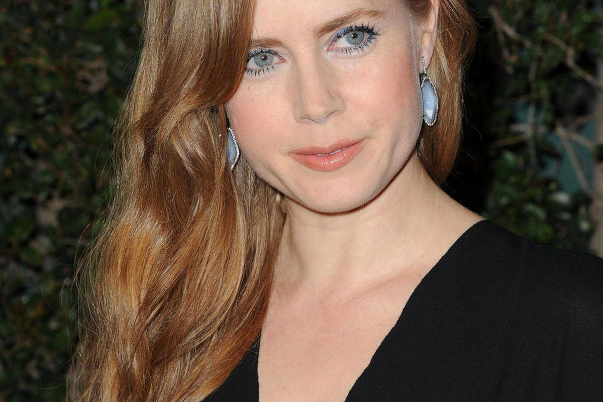 """FILE - In this Feb. 20, 2011 file photo, actress Amy Adams arrives at Vanity Fair Campaign Hollywood at Siren Studios in Los Angeles. Adams, who played a princess in the film """"Enchanted,"""" will be returning to fairy tales this summer, starring opposite Cin"""