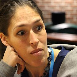 ESPN's Rebecca Lobo listens to a question from the media.