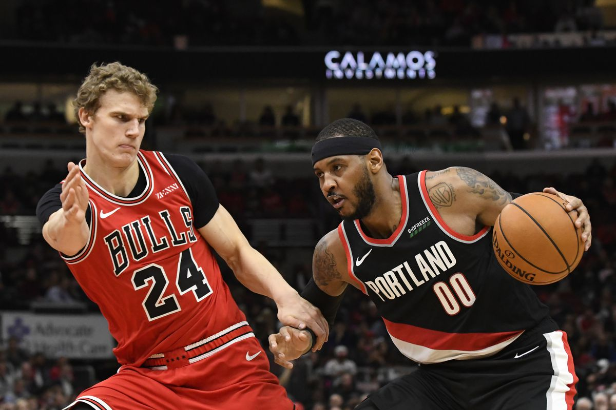 Portland Trail Blazers forward Carmelo Anthony drives on Chicago Bulls forward Lauri Markkanen during the second half at United Center.