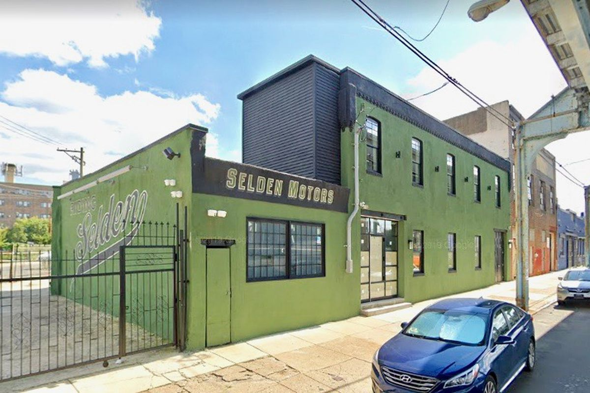green building with sign that says selden motors