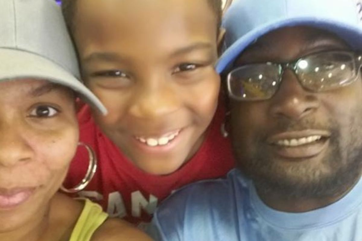 Keith Lamont Scott, who was shot and killed by police in Charlotte, North Carolina, with his wife and son.