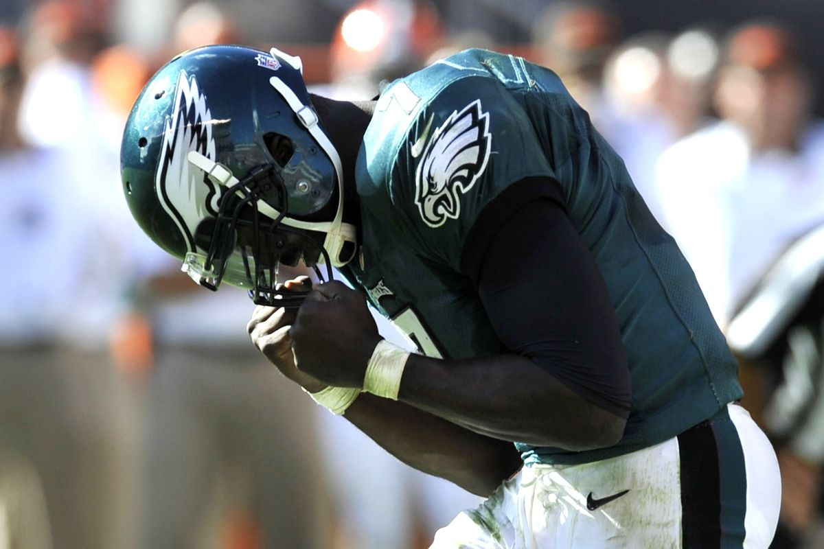 Sep 9, 2012; Cleveland, OH, USA; Philadelphia Eagles quarterback Michael Vick (7) celebrates a touchdown pass against the Cleveland Browns in the fourth quarter at Cleveland Browns Stadium. Mandatory Credit: David Richard-US PRESSWIRE