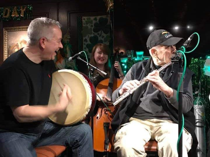 Flautist and music teacher Noel Rice (right) performing in March with his group Baal Tinne. His son Kevin is on the left on the bodhran drum and Catriona Byrne is at center. | Facebook photo