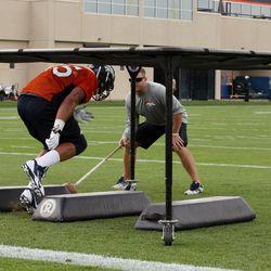 Derek Wolfe participates in individual drills.