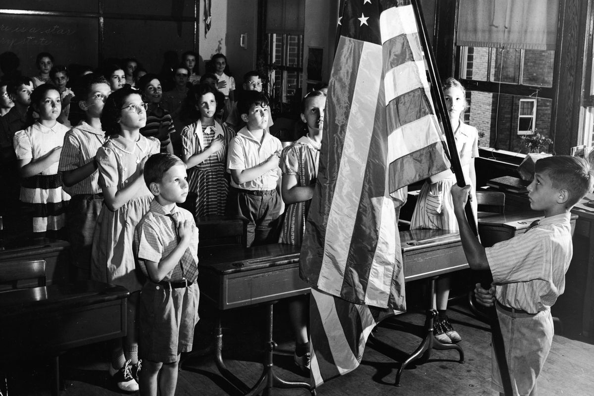 Students pledge allegiance to the flag. The role of patriotism in history classes is an old debate.