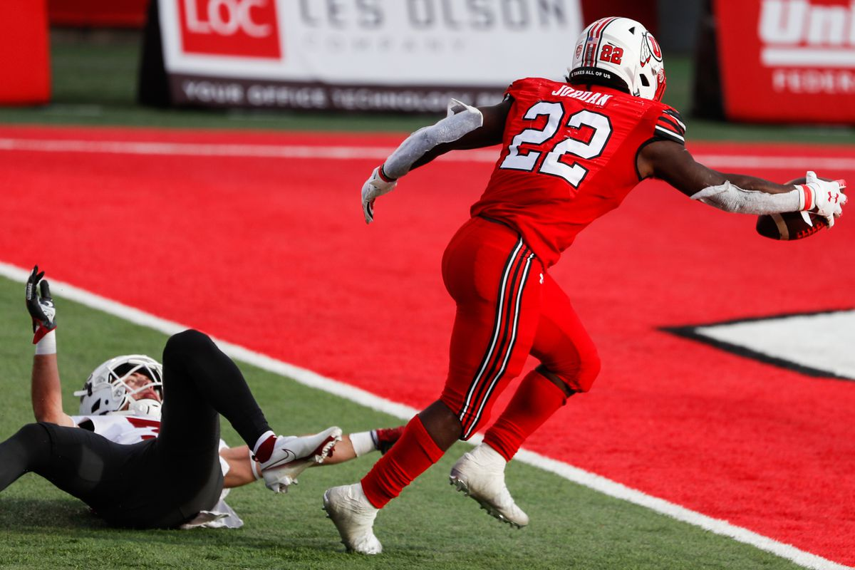 Utah Utes running back Ty Jordan (22) carries the ball into the end zone for a touchdown during an NCAA football game at Rice-Eccles Stadium in Salt Lake City on Saturday, Dec. 19, 2020.