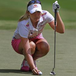Lexi Thompson sets her ball on ninth green during the third round of the Mobile Bay LPGA Classic golf tournament, Saturday, April 28, 2012, in Mobile, Ala.