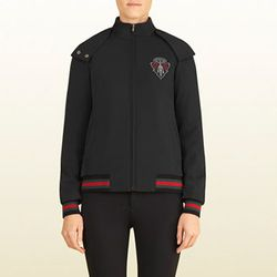 """<strong>Gucci</strong> Equestrian Collection Black Padded Jacket with Gucci Crest, <a href=""""http://www.gucci.com/us/styles/310316XT3151060?gclid=CMm7uonzobkCFYaDQgodOQEA4Q#310316XT3151060"""">$1750</a>"""