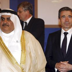 Bahraini Foreign Minister Sheikh Khalid bin Ahmed al-Khalifa, left and NATO Secretary General Anders Fogh Rasmussen, right, are seen before the Libya Contact Group meeting in Doha, Qatar, Wednesday, April 13, 2011. Libyan rebels are in Qatar's capital to call for stronger international pressure on Moammar Gadhafi's regime as Western and Arab envoys gather to discuss options. (AP Photo/Osama Faisal)