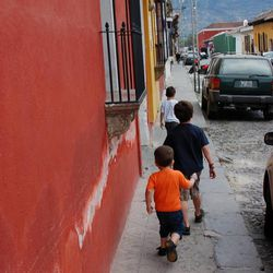 Accustomed to transportation by foot, the three young Dayton brothers navigate the 13 blocks home from an afternoon spent climbing the ruins of La Merced.