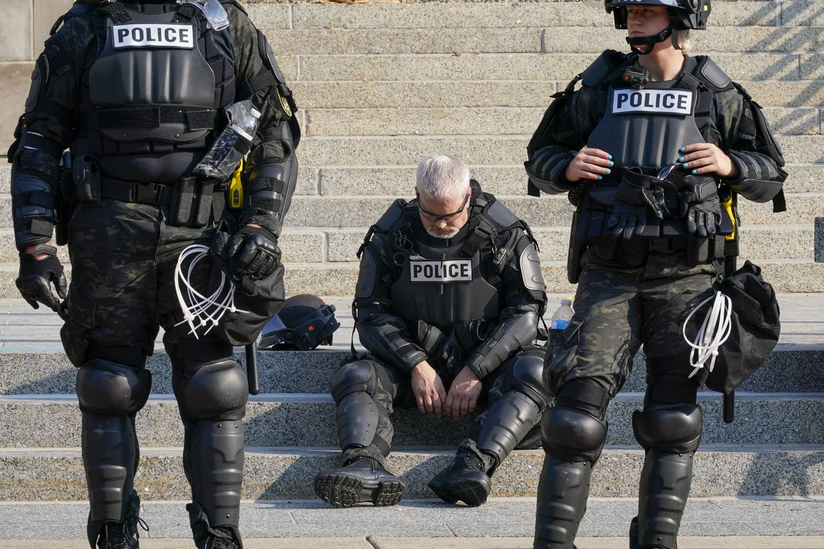 Police in riot gear stand outside the Kenosha County Court House Monday, Aug. 24, 2020.