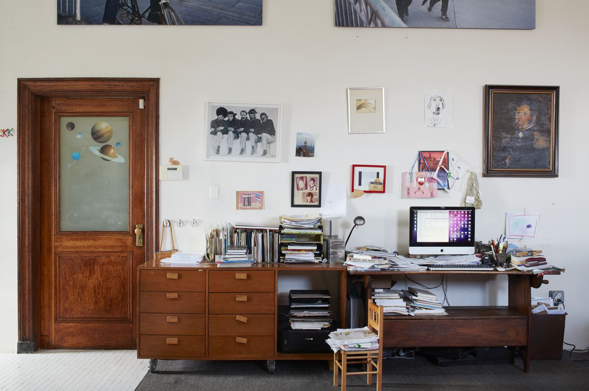 A midcentury desk is tucked between the kitchen and living room.