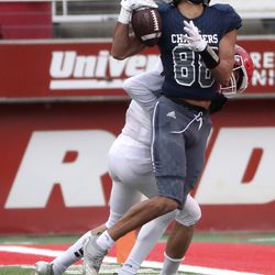 Corner Canyon receiver, Kobe Peters (88), was dismissed by American Fork's Taylor Crump (1) in the 6A football match between American Fork and Corner Canyon at Rice-Eccles Stadium in Salt Lake City on Friday, November 22, 2019.