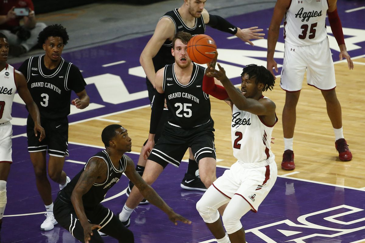 New Mexico State Aggies forward Donnie Tillman passes the ball against Grand Canyon Antelopes forward Oscar Frayer during the second half at GCU Arena.