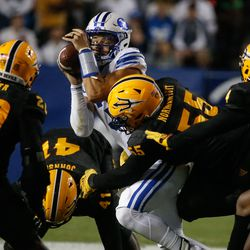 Brigham Young quarterback Jaren Hall gets pressed by Arizona State defenders during an NCAA college football game at LaVell Edwards Stadium in Provo on Saturday, Sept. 18, 2021.