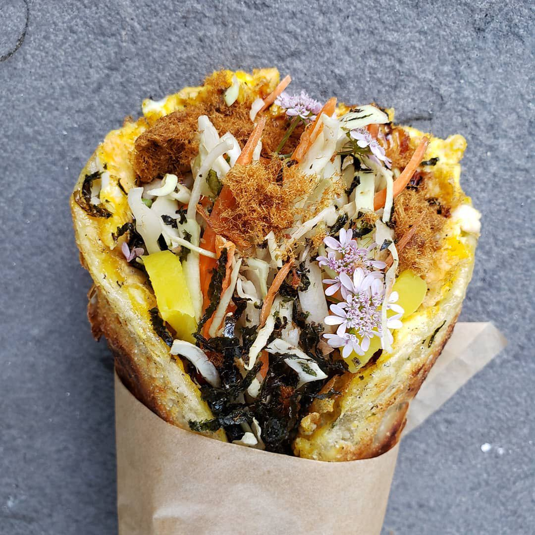 The Taiwan Taco swaps a scallion pancake for a tortilla wrapped around eggs, pork floss, pickles, and avocado.