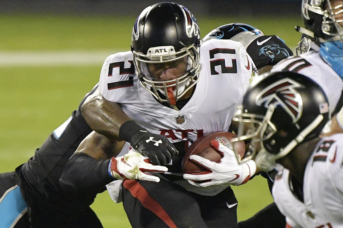 Todd Gurley #21 of the Atlanta Falcons runs against the Carolina Panthers during the first quarter at Bank of America Stadium on October 29, 2020 in Charlotte, North Carolina.