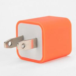 """And if they need some juice at their desk, there's always a neon plug: <b>Urban Outfitters</b> USB Charger, <a href=""""http://www.urbanoutfitters.com/urban/catalog/productdetail.jsp?id=30244016&parentid=SHOP_STOCKINGSTUFFERS&color=085"""">$12</a>"""